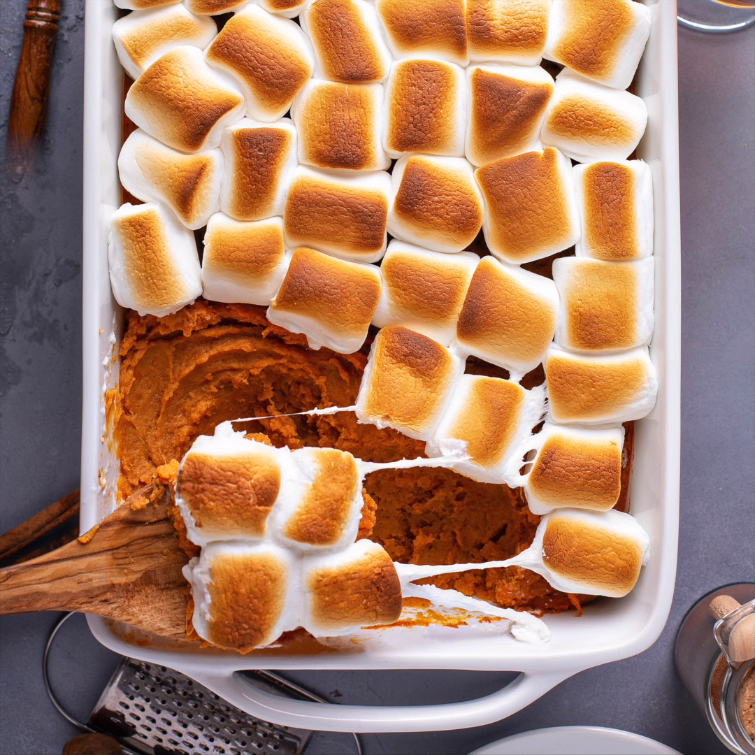 My Mama's Sweet Potato Casserole recipe is loaded with marshmallows, butter, cinnamon and a secret ingredient to win the title of best Thanksgiving side dishes! #SweetPotatoCasserole #Thanksgiving #ThanksgivingSideDish #ThanksgivingCasserole #Casserole #sweetpotatocasserolewithmarshmallows