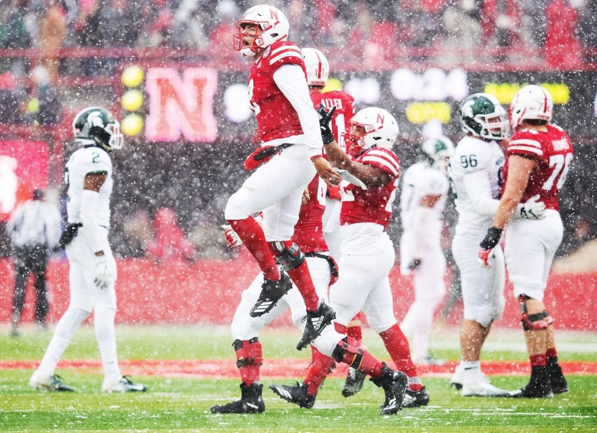 Nebraska's Adrian Martinez jumps in the air after a