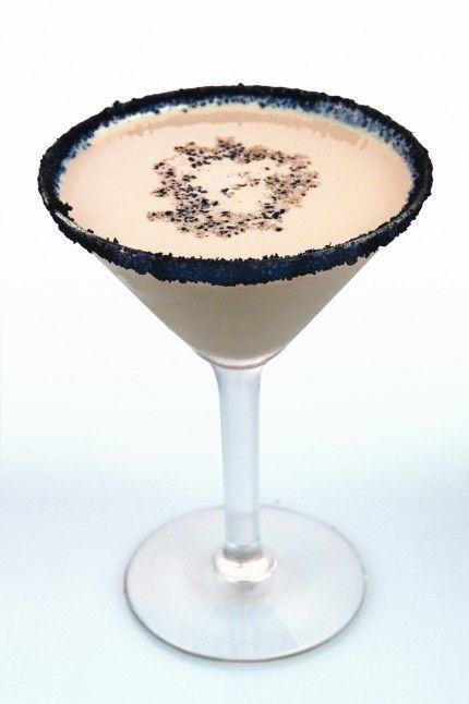 Reindeer Tracks ~ Dutch Chocolate Vodka, Hazelnut Liqueur, Crème de Cacao, a Splash of Cream, Chocolate cookie wafers for glass edge