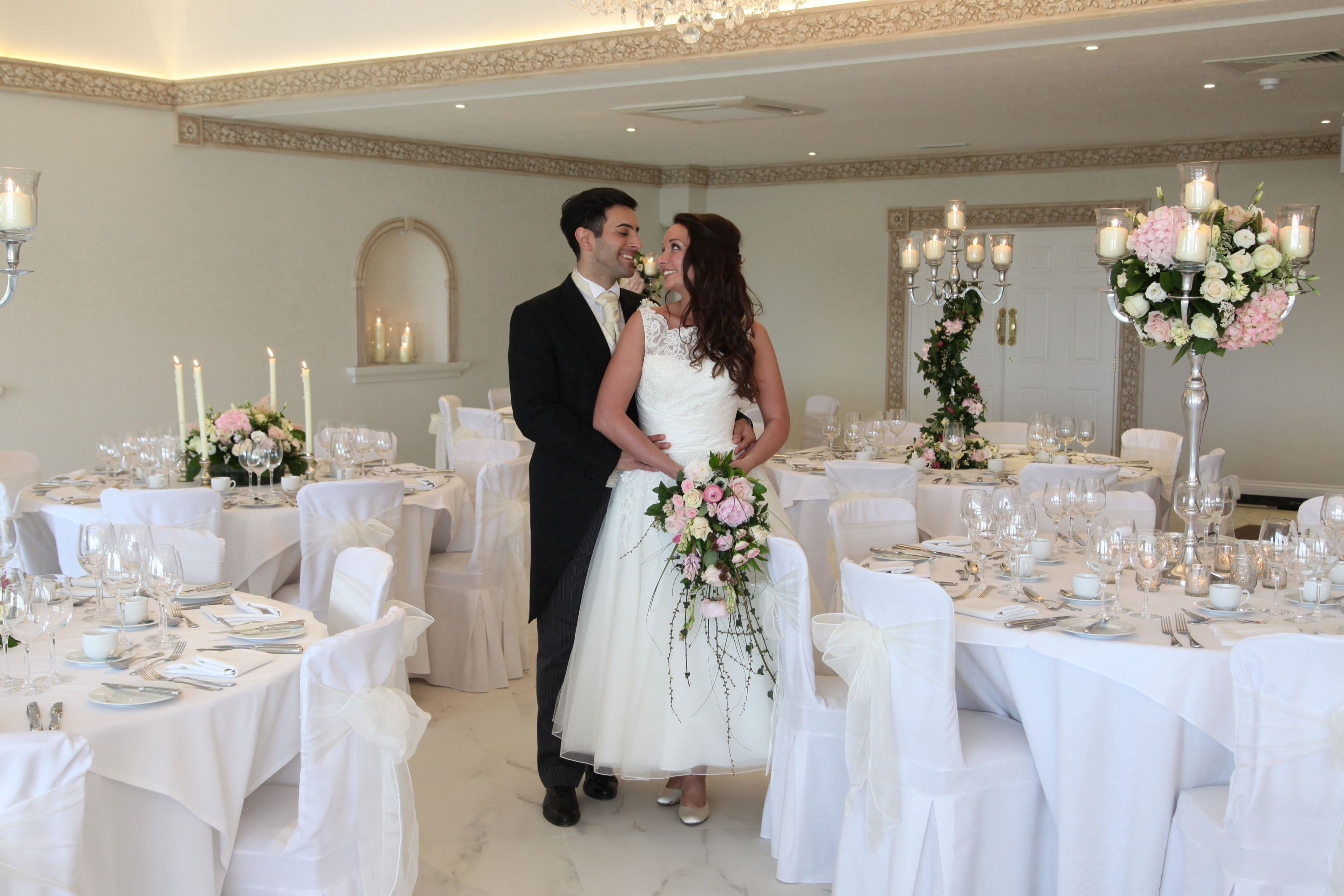 The ballroom at Froyle Park dressed in ivory sashes and white