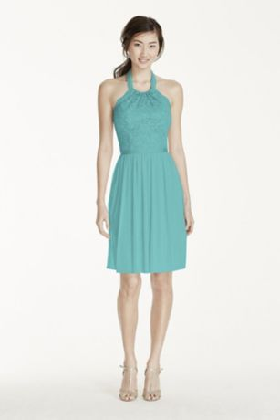 This bridesmaid dress is ultimately flattering for any affair!  Features a lace bodice with an illusion neckline and tie back halter.  Mesh skirt with grosgrain ribbon at waist finishes off the look.  Fully lined. Back zip. Lace 52% Nylon/48% Rayon, Mesh 100% Polyester. Dry clean only.  To protect your dress, try our Non Woven Garment Bag.