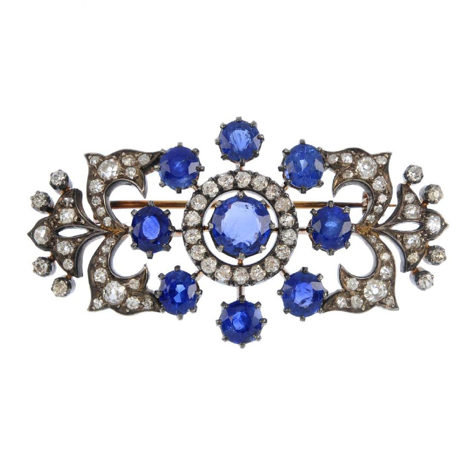 carved star and sapphire emerald brooch