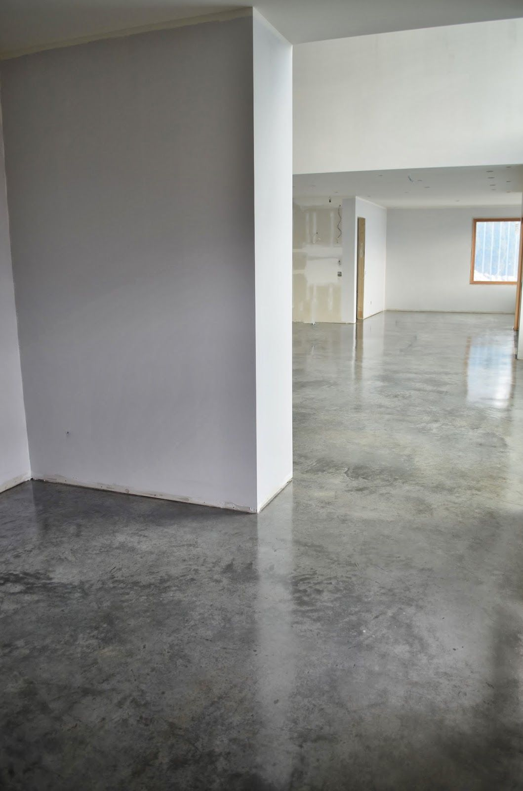 simple waxed concrete floors - option for floor finish with big area rugs  for warmth and color.