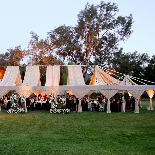 The open air reception tent was draped with airy nude-colored fabric perfect for & The open air reception tent was draped with airy nude-colored ...