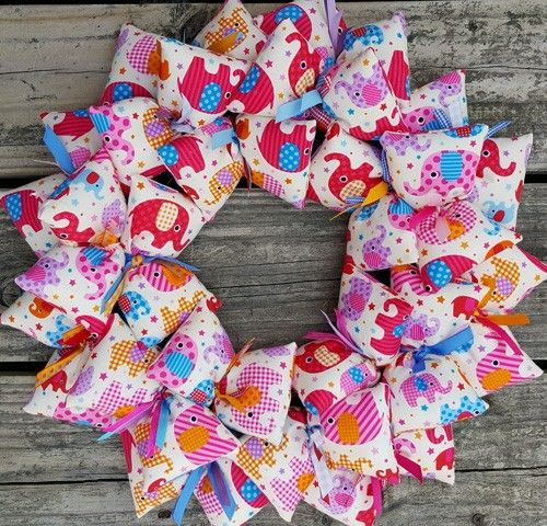 What a blast this kid's wreath is!  Using one fabric pattern of fun graphic elephants, this SooBoo Designs wreath is truly exciting to look at on your wall.  Such a terrific gift for a young girl with