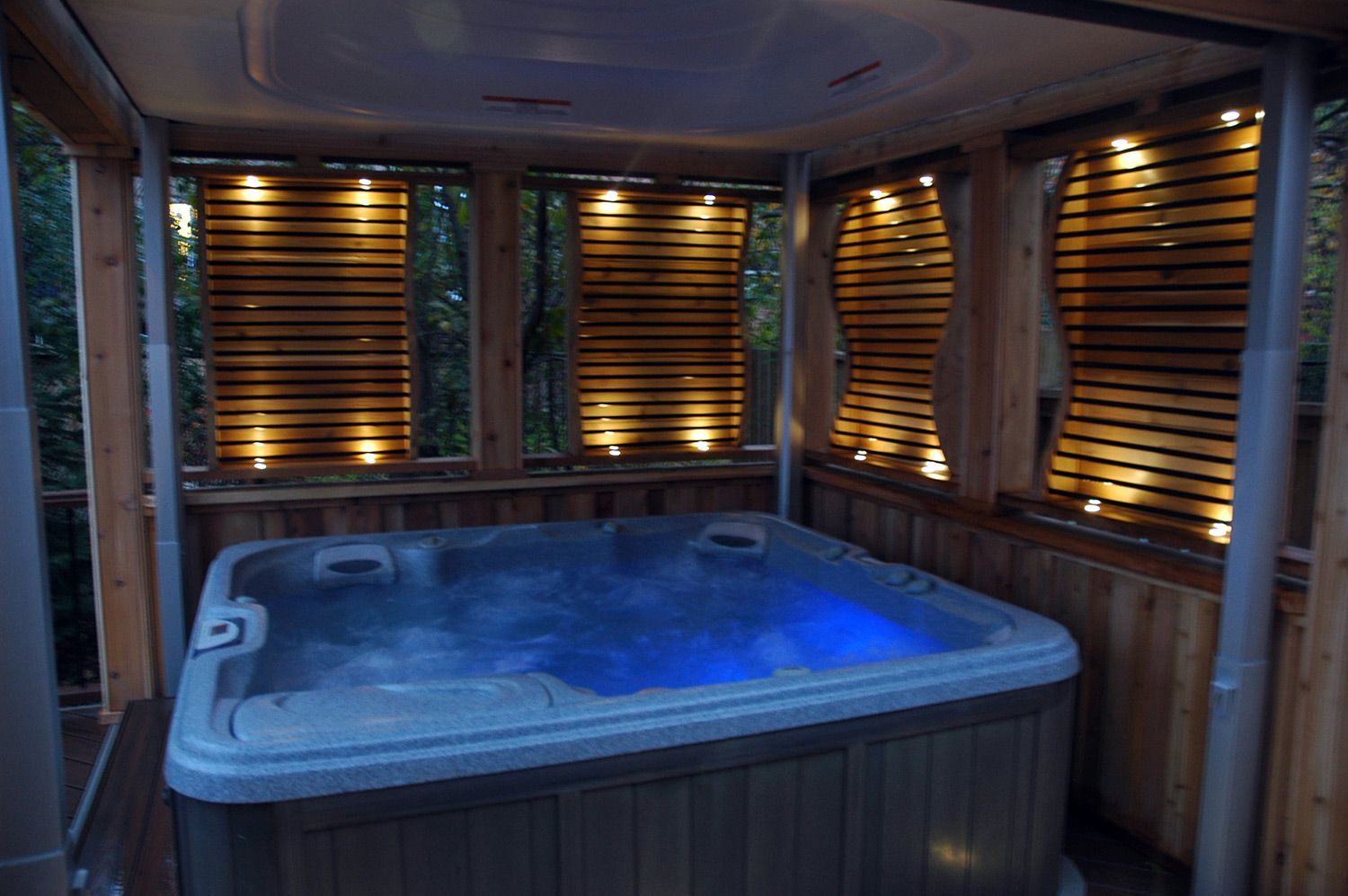enclosed hot tub area complete with lighting privacy