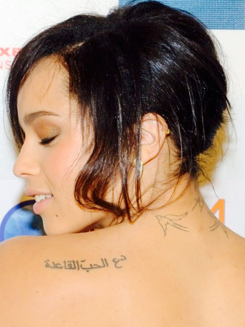 Zoe Kravitz Tattoos Arabic Let Love Rule And Birds Zoe Kravitz Tattoos Tattoos Behind Ear Tattoo