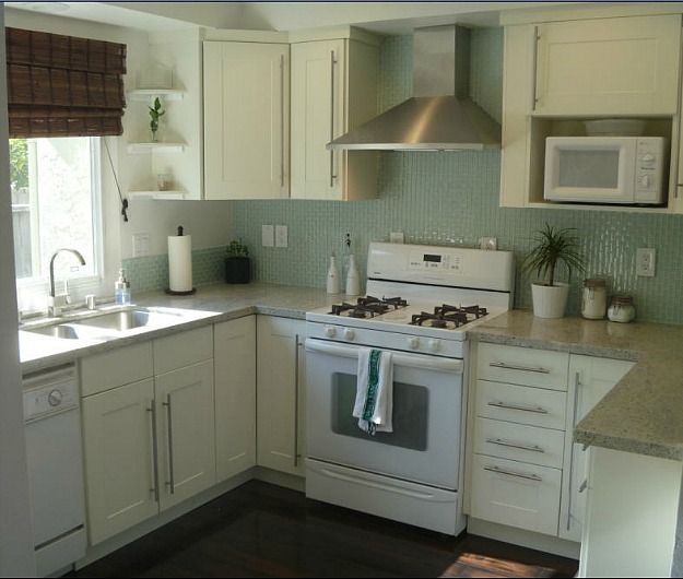Glass tile back splash adds  lot to this kitchen white cabinet kitchenkitchen colorskitchen also small er kitchens my readers cook in dark wood and house