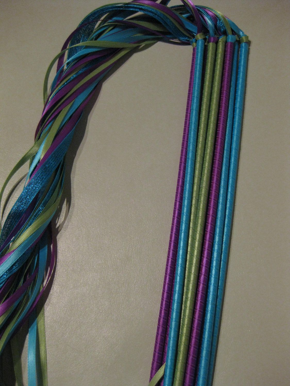 Peacock Wedding Ribbon Wands. $15.00, via Etsy. More eco friendly option, no litter, no cleanup.
