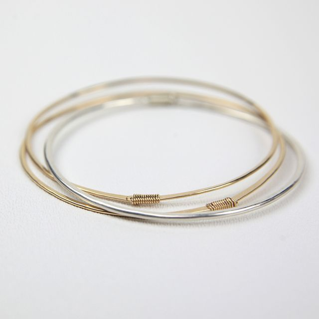 Set of Two Gold and One Silver Bracelets