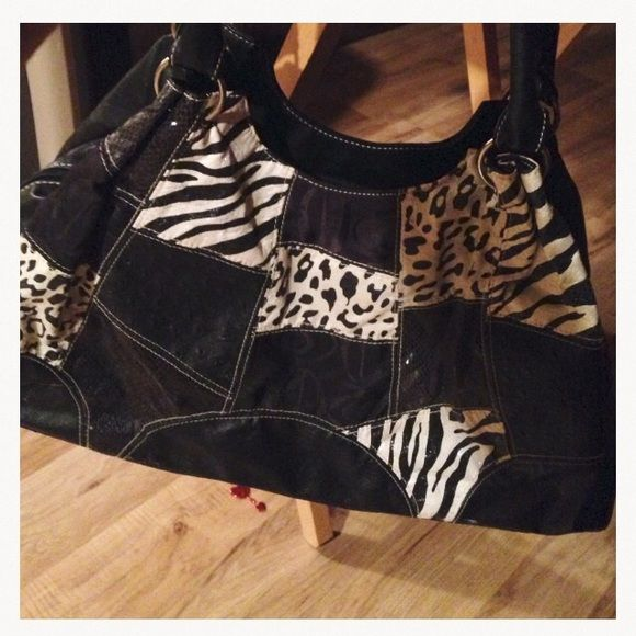 Super Nice Leather Purse‼️‼️ON SALE‼️‼️ Patchwork multi textured patterns, ostrich, snake, shimmer zebra & cloth trimmed in super soft leather NEWnever used Bags Shoulder Bags