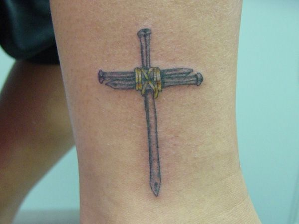 Two Nails Crossed Tattoo Meaning: Pin On Tattoos