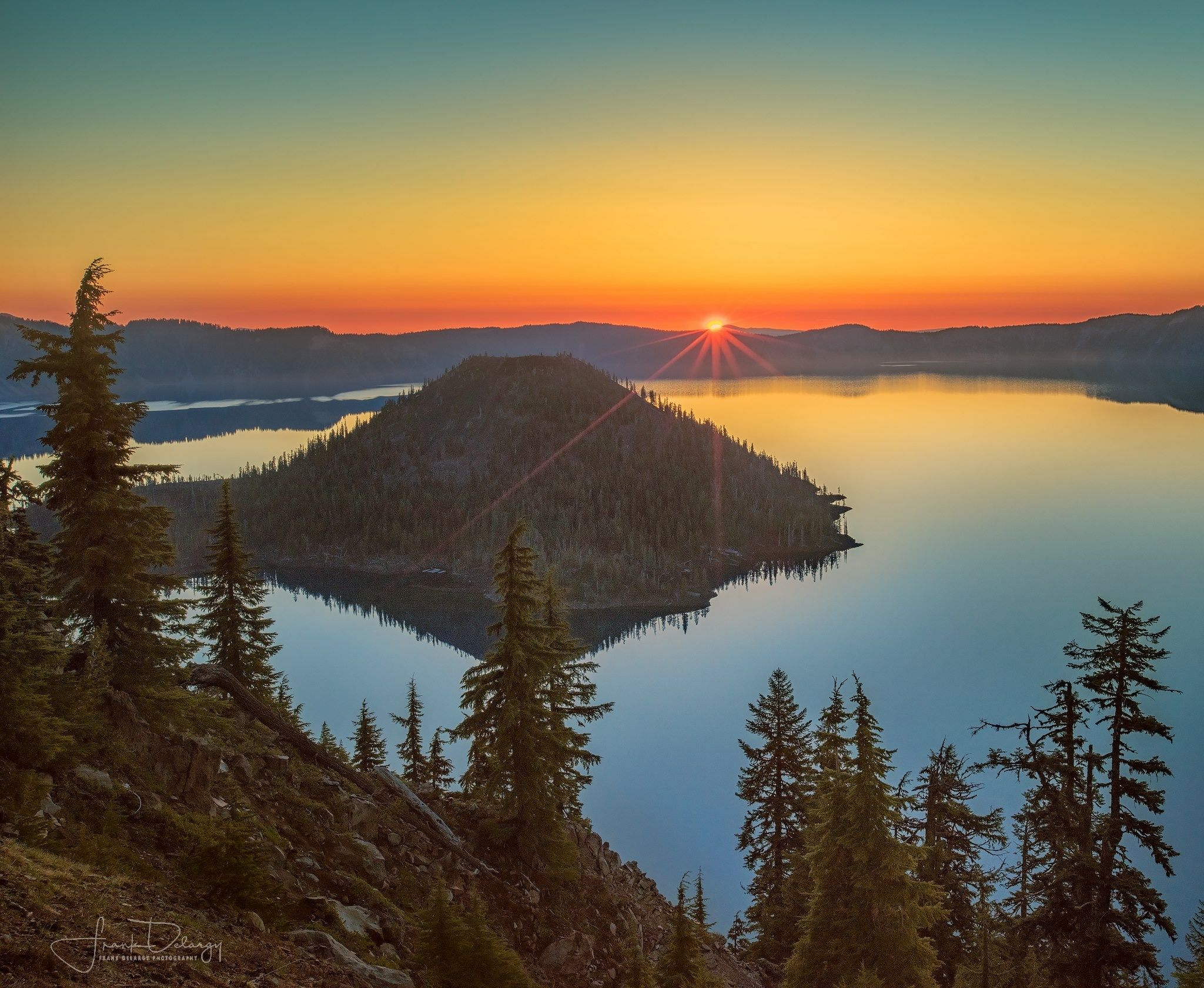 Oregon. Crater Lake NP, sunrise light on Wizard Island