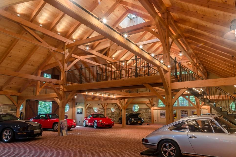 The main space in this timber frame car barn is dedicated to automobiles a custom steel catwalk - Man cave ideas for small spaces collection ...