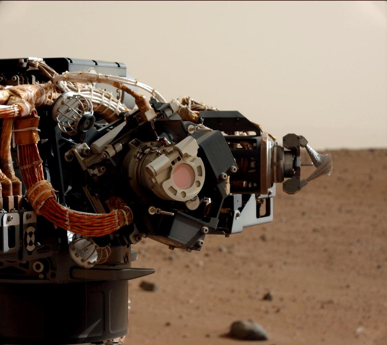 The left eye of the Mast Camera (Mastcam) on NASA's Mars rover Curiosity took this image of the camera on the rover's arm, the Mars Hand Lens Imager (MAHLI), during the 30th Martian day, or sol, of the rover's mission on Mars (Sept. 5, 2012). MAHLI is one of the tools on a turret at the end of the rover's robotic arm. When this image was taken, the arm had raised the turret to about the same height as the camera on the mast. The Mastcam's left eye has a 34-millimeter focal length lens.