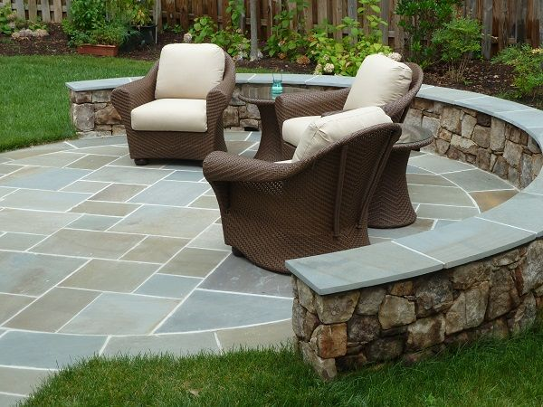 Genial Round Flagstone Patio Surrounded By Fieldstone Seating Wall And Garden With  Shrubs And Perennials