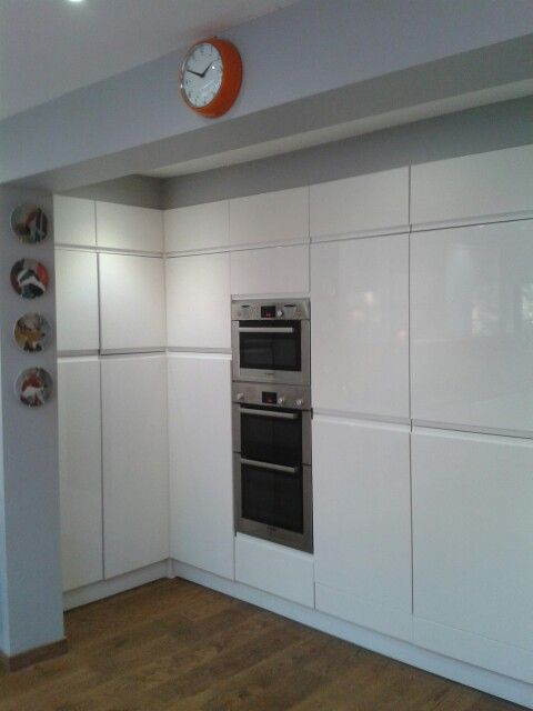 kitchen storage with bosch microwave double oven and integrated full fridge and siemens freezer