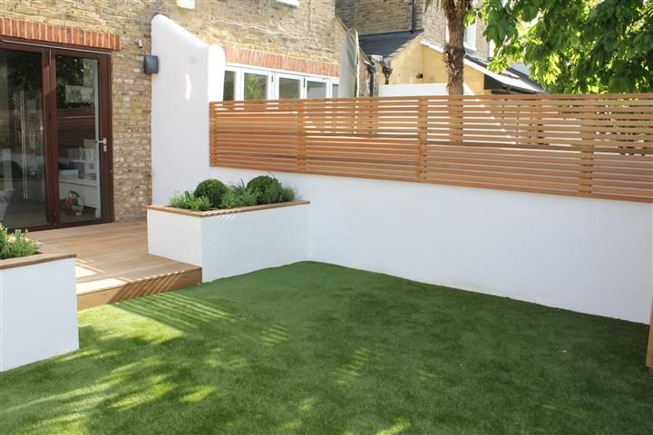 clean lines and low maintenance garden in south london - Garten Steinmauer Terrasse
