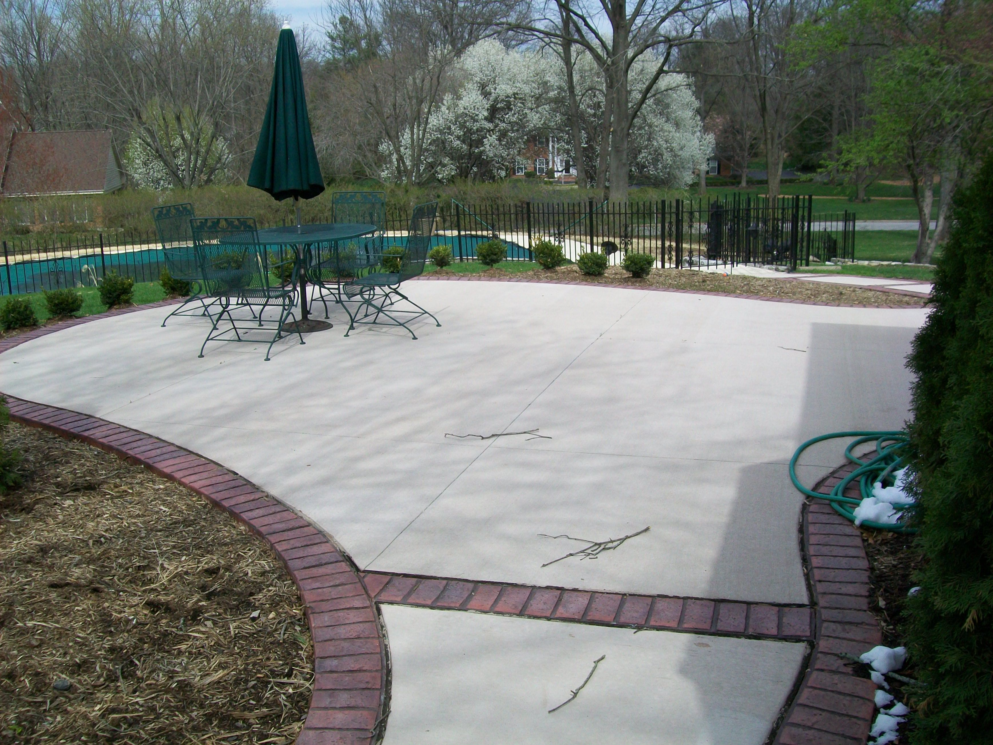 Colored Concrete Patio With Stamped Concrete Brick Boarder Concrete Patio Backyard Patio Patio Design