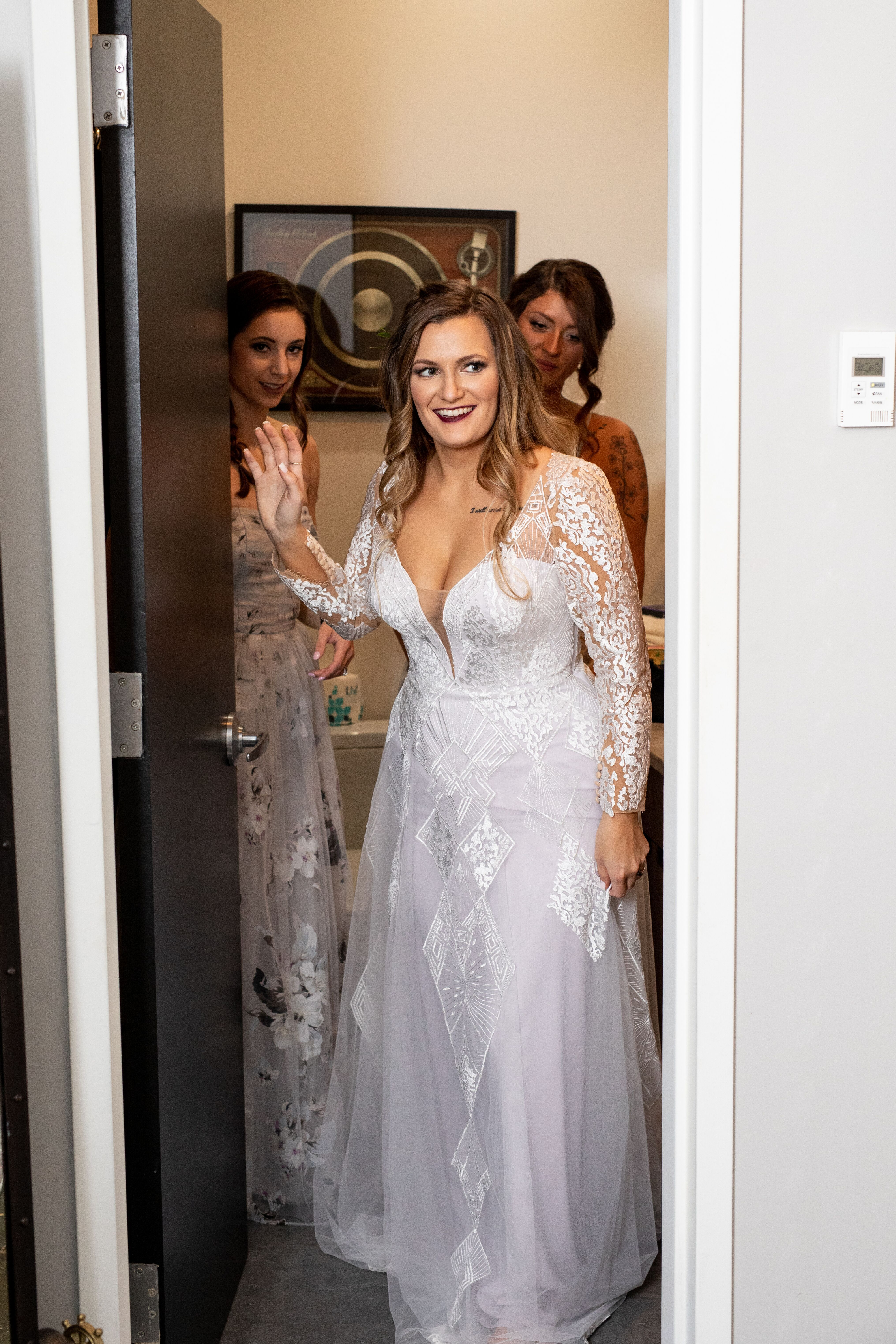 4e4ac9a8f17 Anomalie custom boho wedding gown with skin-toned illusion long sleeves and  a deep V-neck bodice.