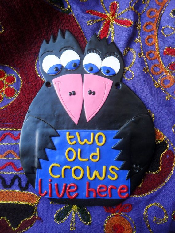 Two old crows live here. wall or garden sign. black crows