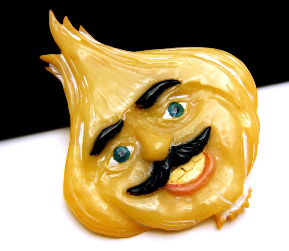 Fabulous Brad Elfrink Carved Bakelite Meester Garlic Man Brooch 2006 Dated…Doesn't this look almost EXACTLY like BURT REYNOLDS from the 70's?