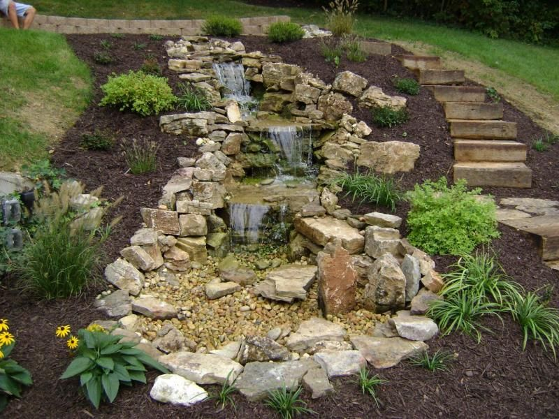 tiered pondless waterfall, limestone boulders, retaining wall