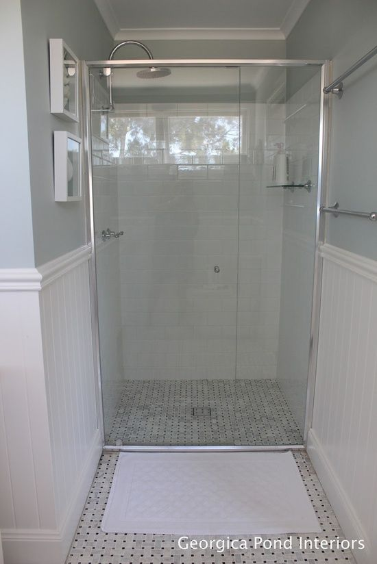 Frameless (semi) shower door and basketweave tile..