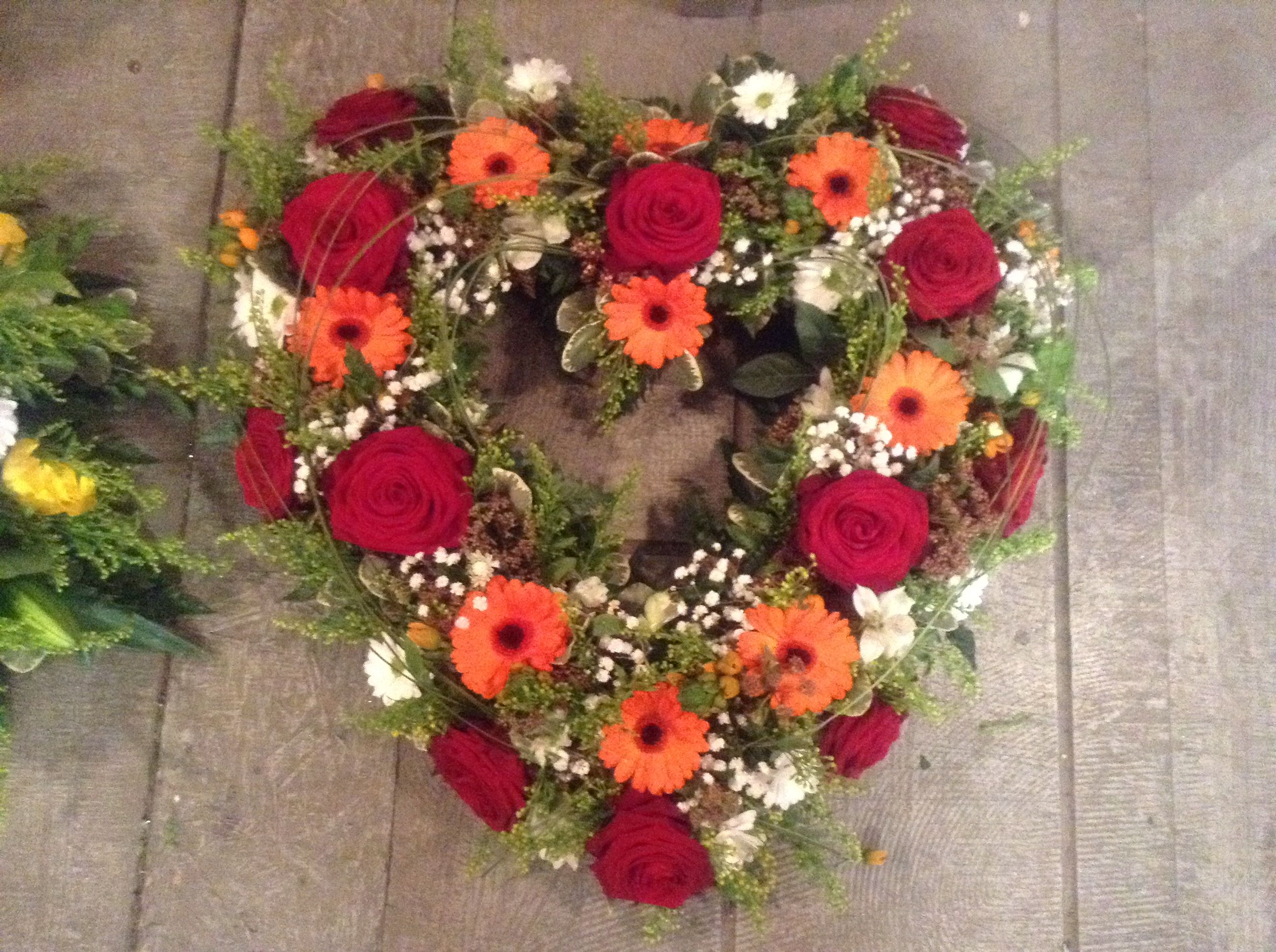 Funeral flowers love heart funeral tribute deep red roses bright funeral flowers love heart funeral tribute deep red roses bright orange gerbera open izmirmasajfo Image collections