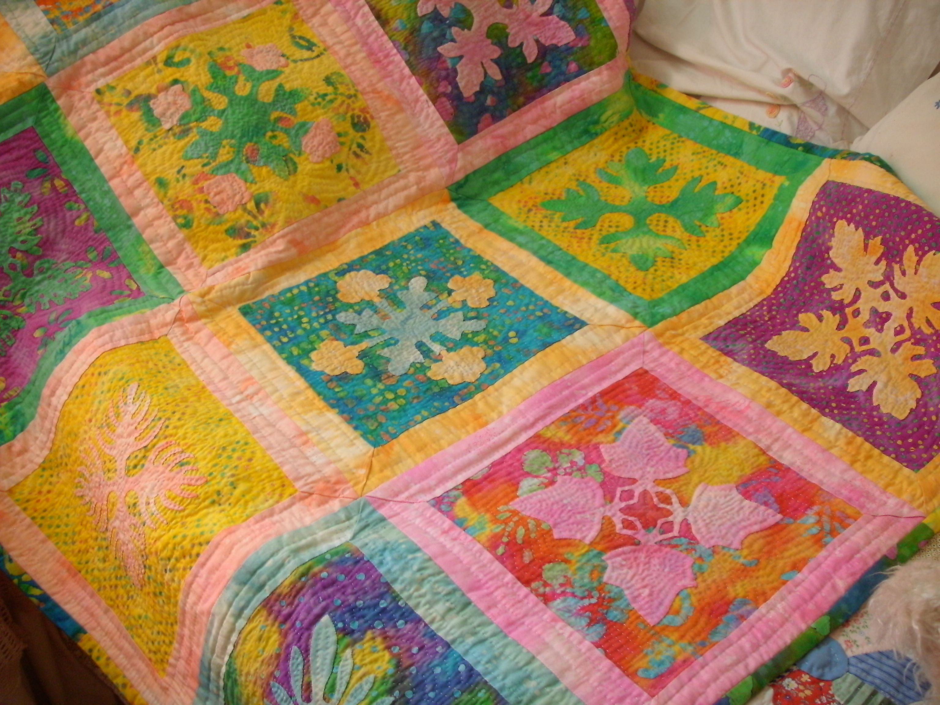 An Hawaiian quilt using smaller blocks than usual.  I did it in all the hand applique and hand quilting one block at a time, joining them the Georgia Bonesteel way.  I used the Elizabeth Root book, 'The Pillows to Patch Quilt Collection'.