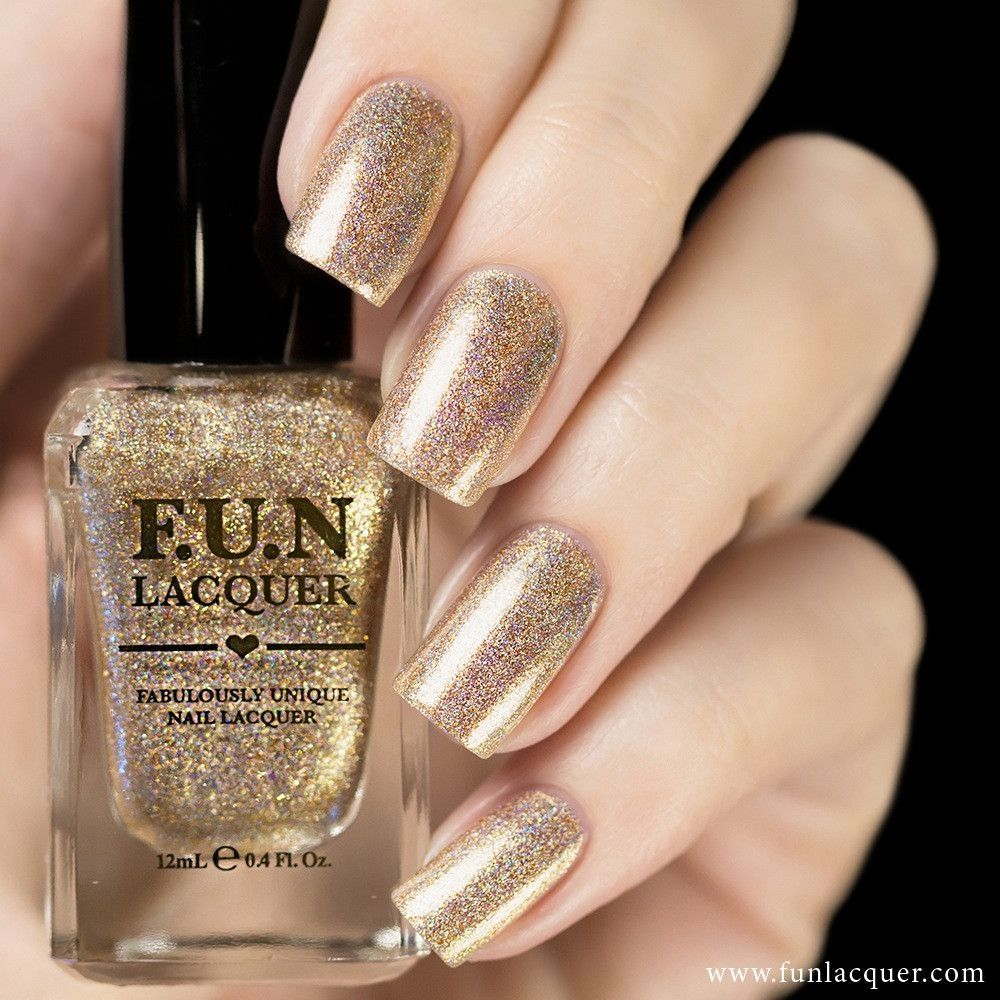 It\'s time to celebrate with this gold shimmery glitter nail polish ...