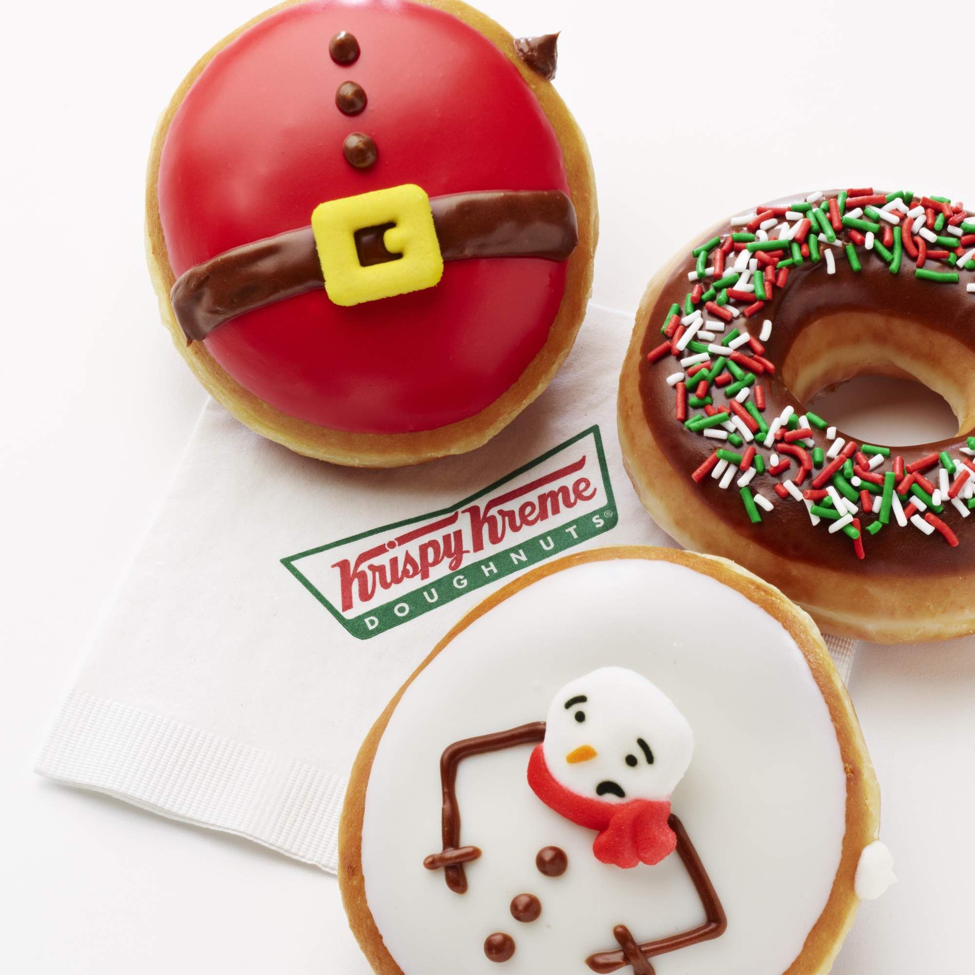 Krispy Kreme S New Holiday Donut Comes With Hot Cocoa Filling Christmas Donuts Holiday Donuts Krispy Kreme