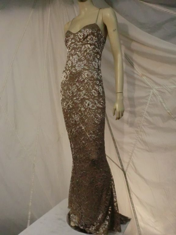 Calvin Klein Champagne Silk Metallic Lace Gown with Fishtail Train | From a collection of rare vintage evening dresses at http://www.1stdibs.com/fashion/clothing/evening-dresses/