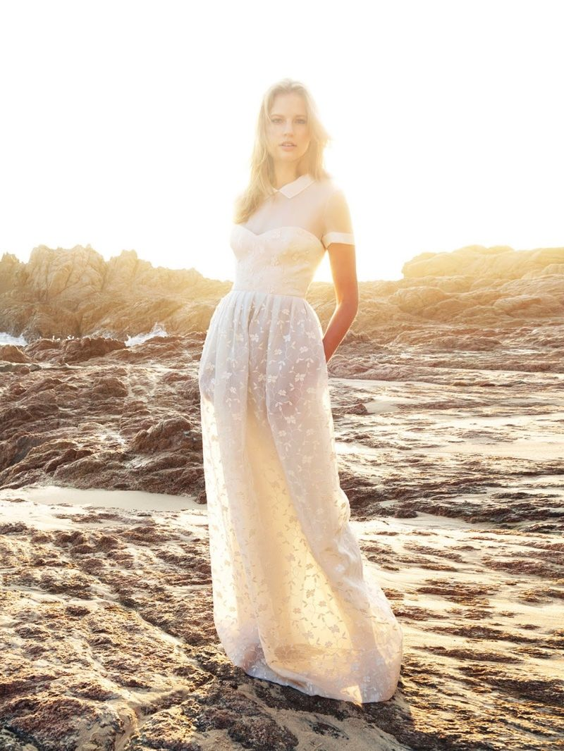 Elisabeth poses in cap-sleeve gown with sheer skirt