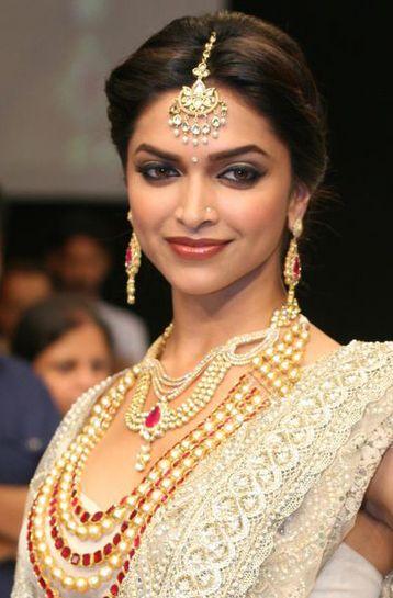 Deepika Padukone in a typical Indian Bridal look ...