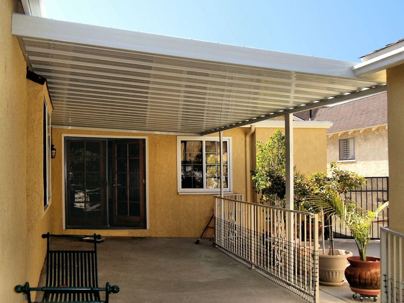 Crest 700 Flat Pan Aluminum Awning over patio | Aluminum ...