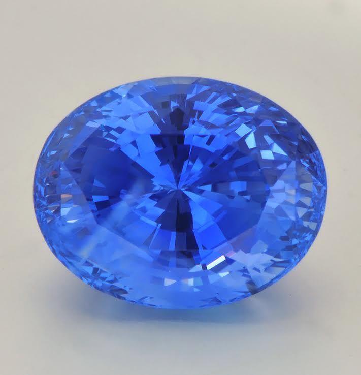 "22 carat, ""cornflower blue"", Ceylon sapphire: Color Description Slightly greenish blue to violetish blue Genuine sapphires, part of the Corundum gem family. Mohs' hardness rating of 9."