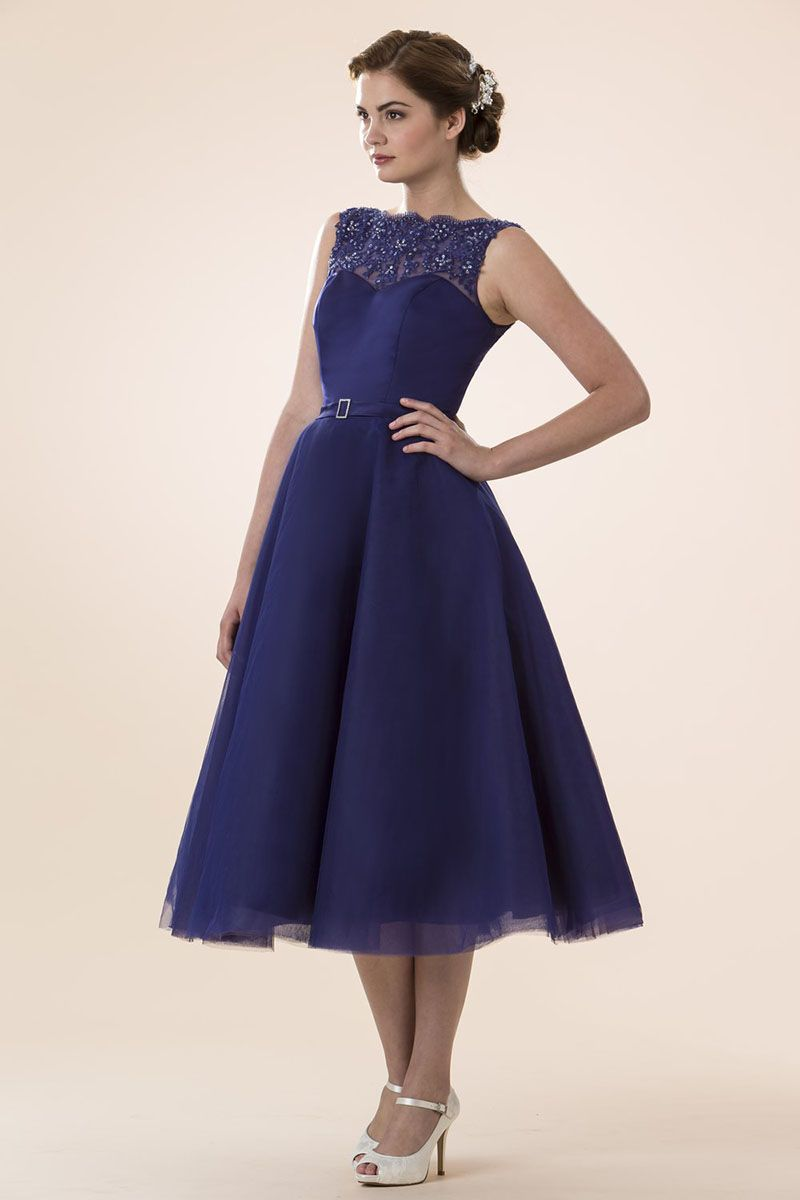 Light blue tulle illusion neck sleeveless tea length bridesmaid