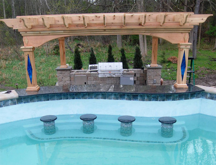 Gunite pool with swim up bar and pergola outdoor kitchen for Outdoor kitchen designs with pool