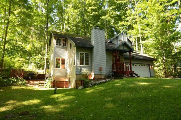 Home @ 8193 Elm Drive with 4 bedrooms and 3.5 bathrooms for $219,900