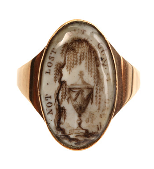 """Georgian remembrance ring. Circa 1760-1820 navette shaped mourning ring in 14k gold which reads: """" Not Lost But Gone Before.""""    Weeping willow and urn painted on ivory."""