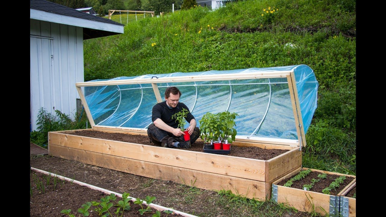 This is my take at a hinged hoophouse for my raised bed. I