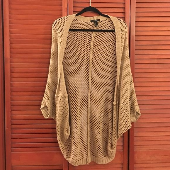 Forever 21 Brown Knit Cardigan Batwing.Reminiscent of the Brandy Melville Cardigan. Worn once. Selling because it doesn't hang right from my shoulders. Sweaters Cardigans