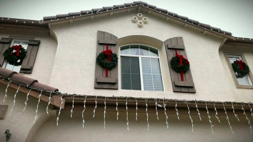 Wreaths on shutters and windows