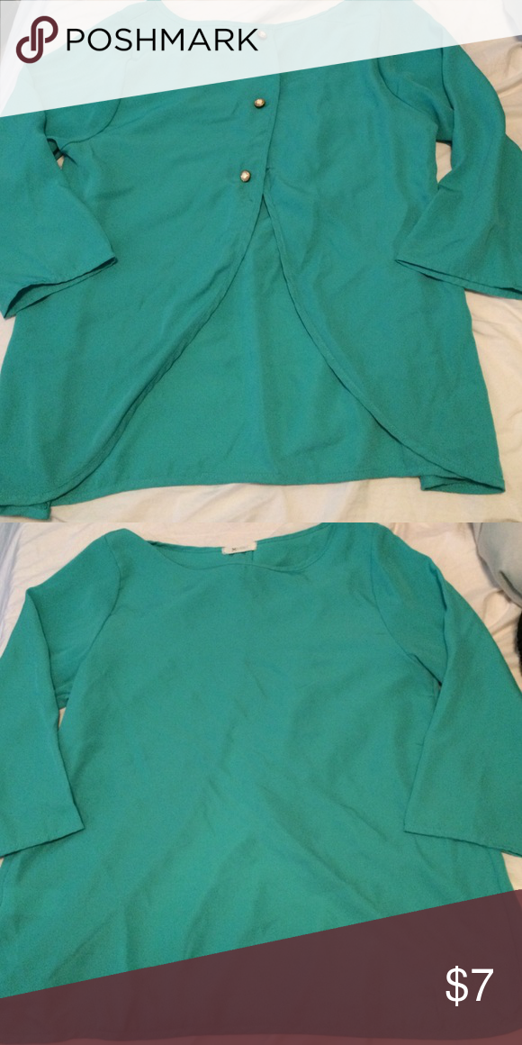Everly Open Back Teal Blouse First pic is of back, the bottom two buttons are not connected to other side of shirt for bust room. Really cute shirt but doesn't fit me. Looks like franchescas Everly Tops Blouses