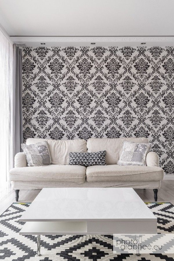 Living room with stylish wallpaper