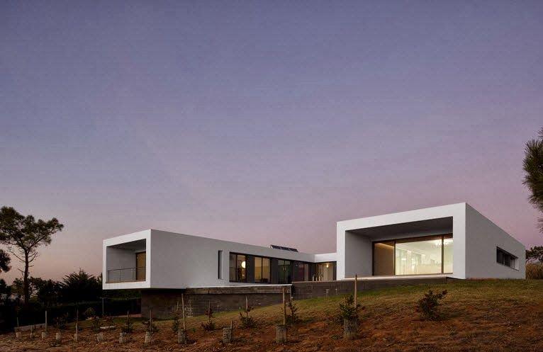 diseño de casa moderna en forma de u frente al mar | architecture