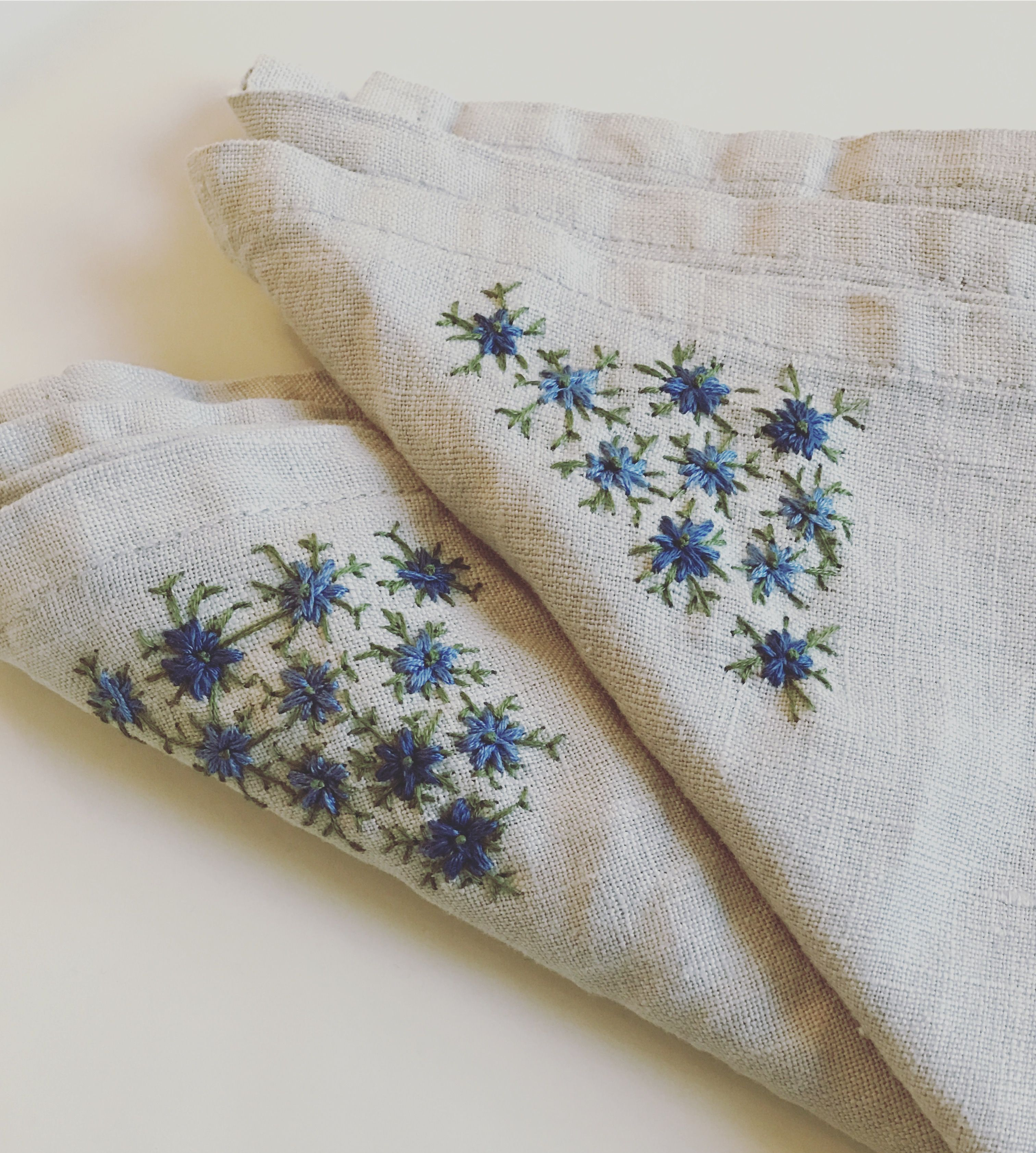 Embroidered linen napkins with love in a mist blue flowers buy on