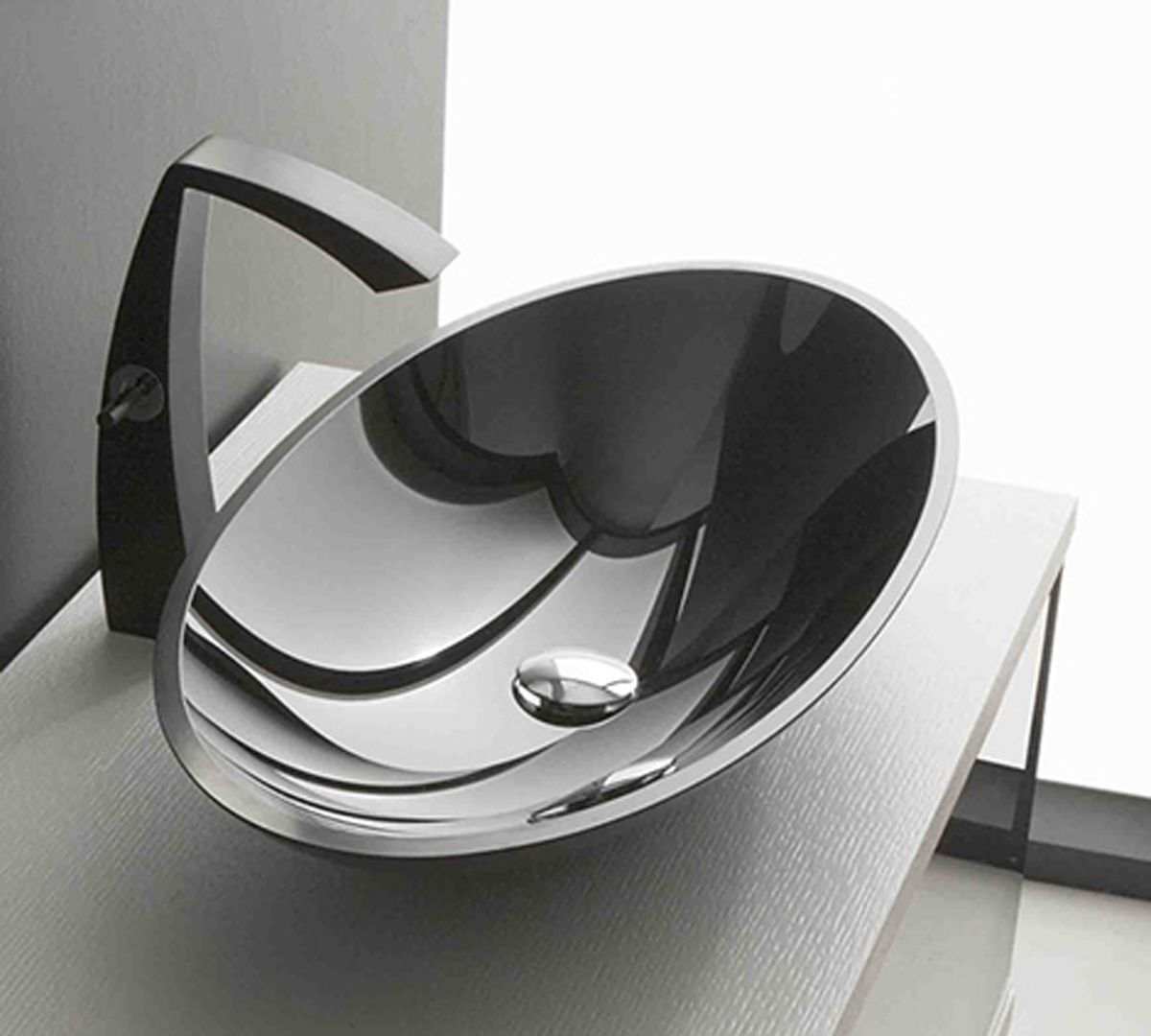 Fascinating Sink With Modern Bathroom Faucets And Oval Bowl Using Reflective Surface