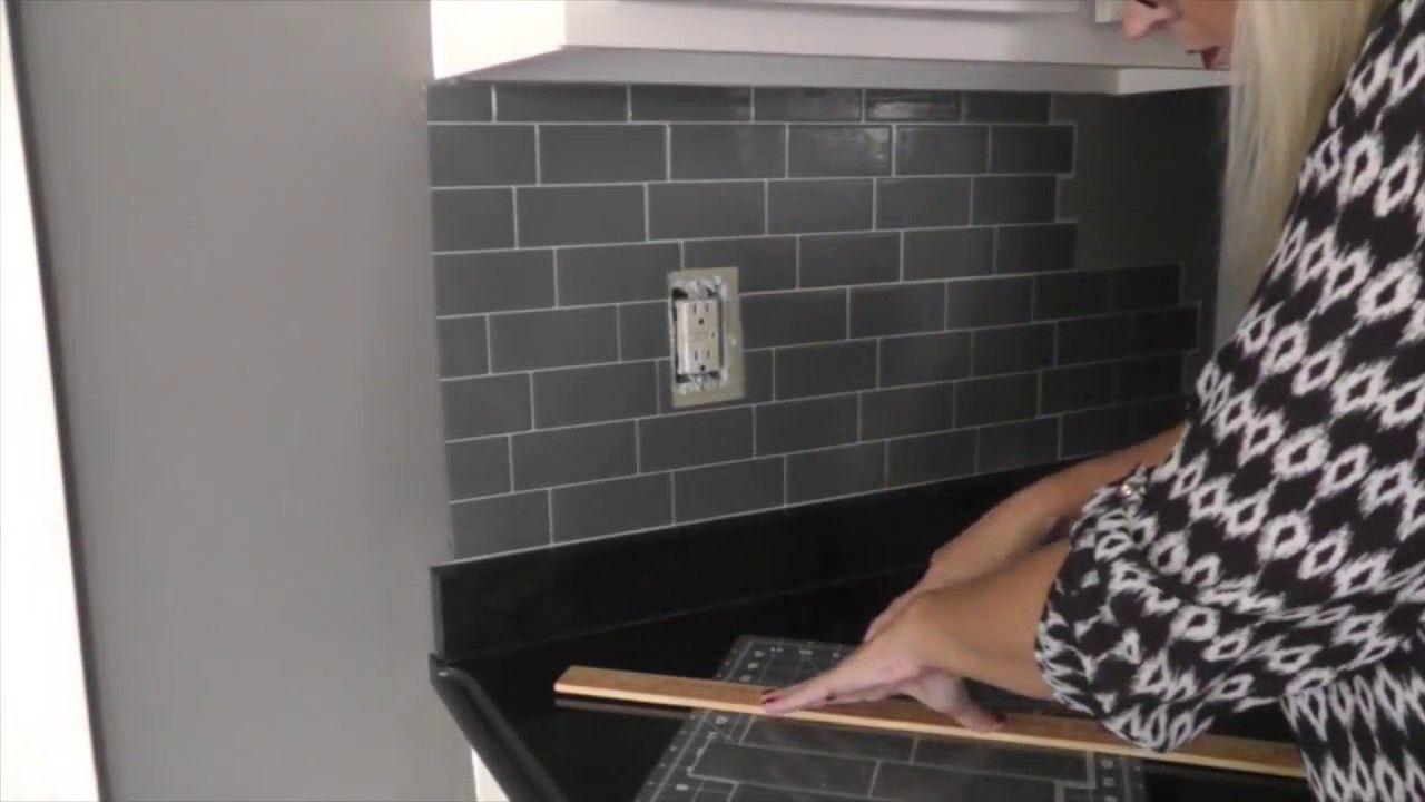 - Smart Tiles Backsplash - I LOVE The Wood Trim She Adds At The End
